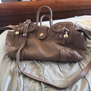 Tan leather See by Chloe bag.